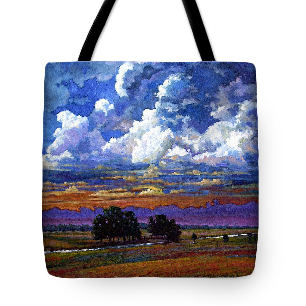 Landscape Tote Bag featuring the painting Evening Clouds Over The Prairie by John Lautermilch