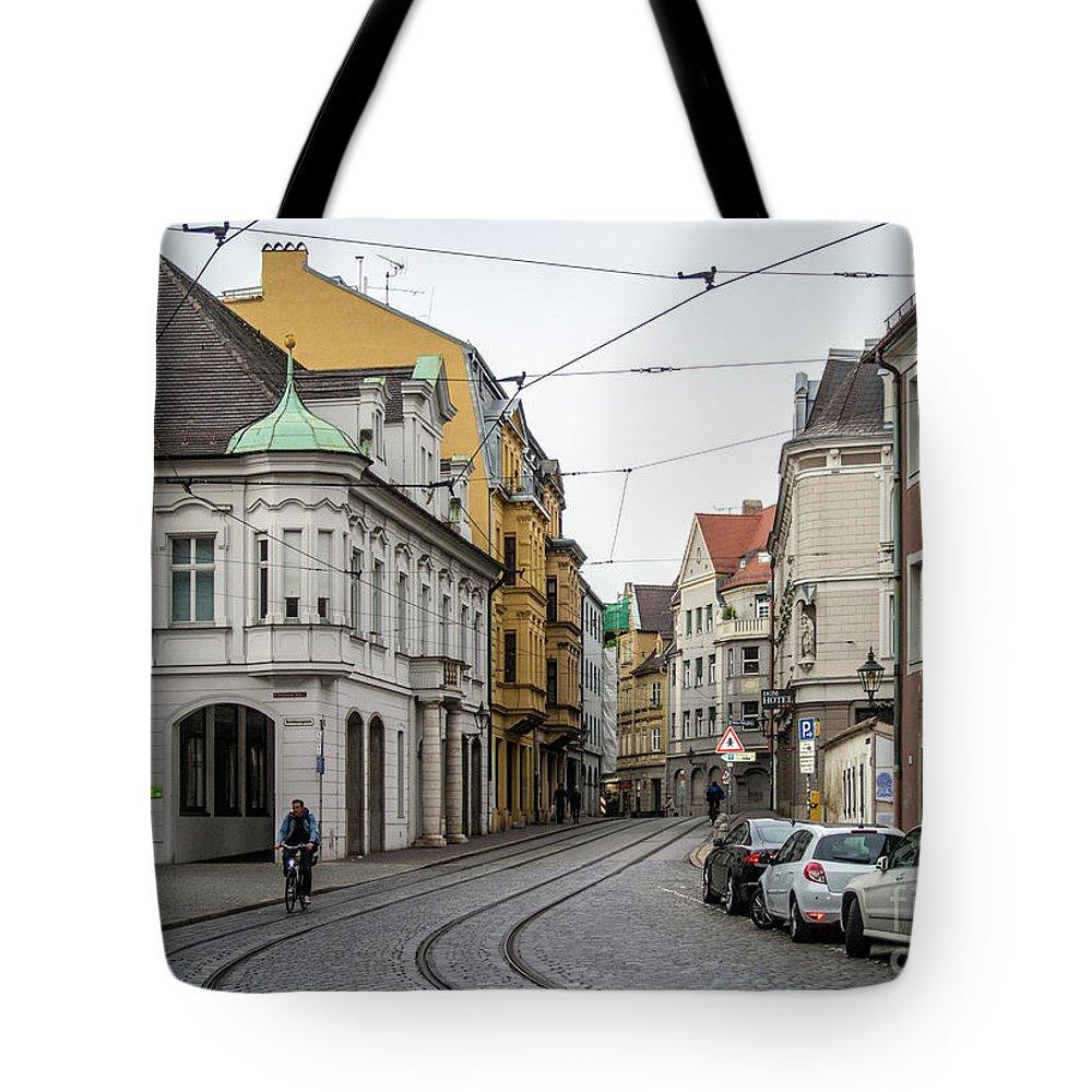 Augsburg Tote Bag featuring the photograph Evening Commuter by Bernd Billmayer
