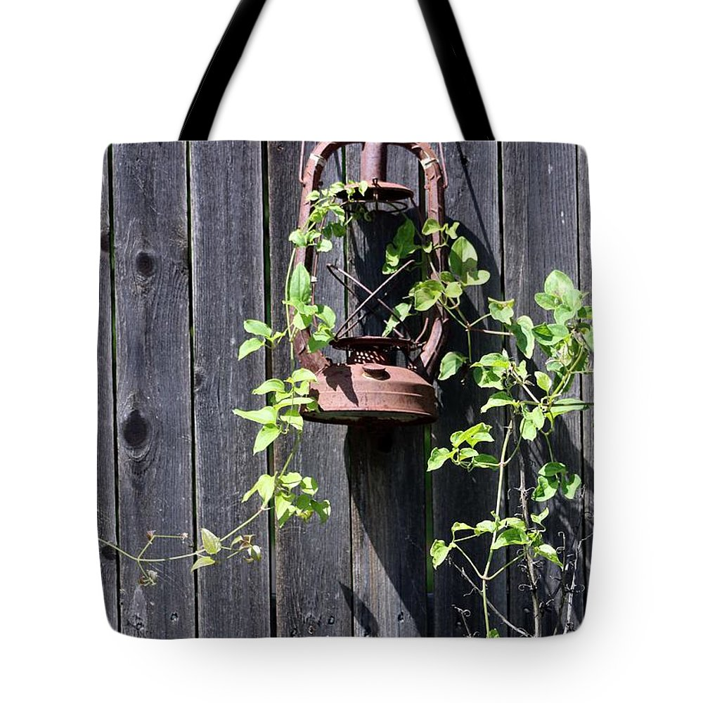 Lantern Tote Bag featuring the photograph Extinguished by Pamela Critchlow