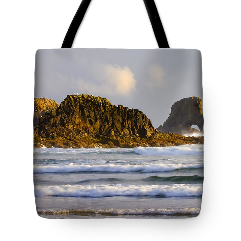 Seastacks Tote Bag featuring the photograph Eye Of The Storm by Mike Dawson