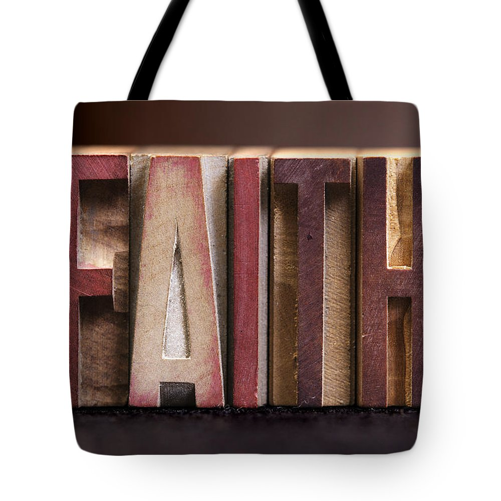 Pray Tote Bag featuring the photograph Faith - Antique Letterpress Letters by Donald Erickson