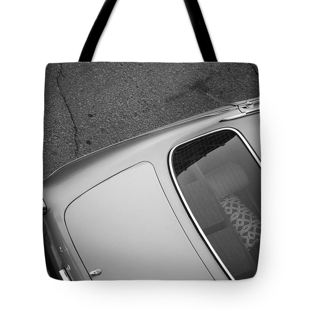 Street Photography Tote Bag featuring the photograph Fall Into Parts by The Artist Project