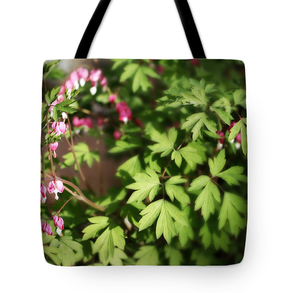 Flower Tote Bag featuring the photograph Fanciful Bleeding Hearts by Marilyn Hunt