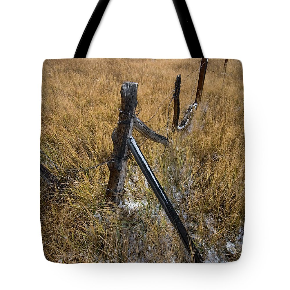Landscapes Tote Bag featuring the photograph Fence To Nowhere by Norman Andrus