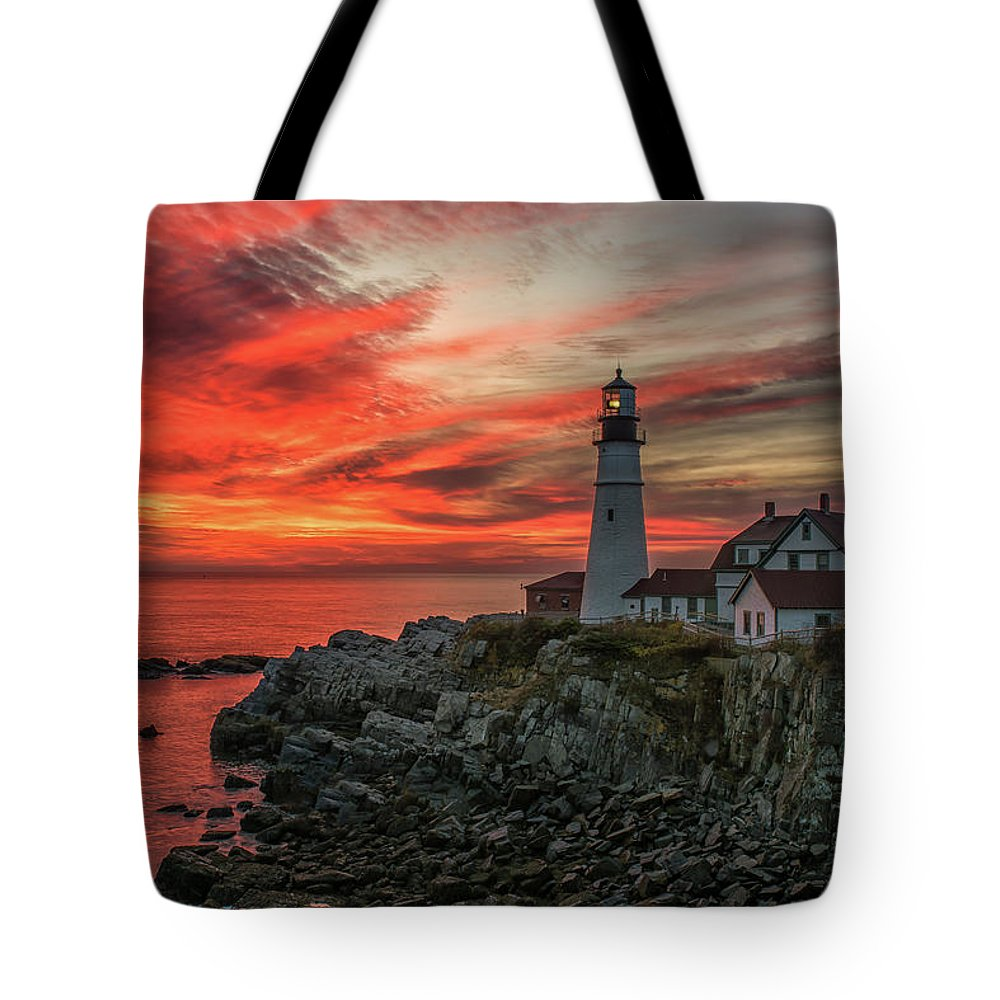 Lighthouse Tote Bag featuring the photograph Fiery Sunrise At Portland Head Light by Jesse MacDonald