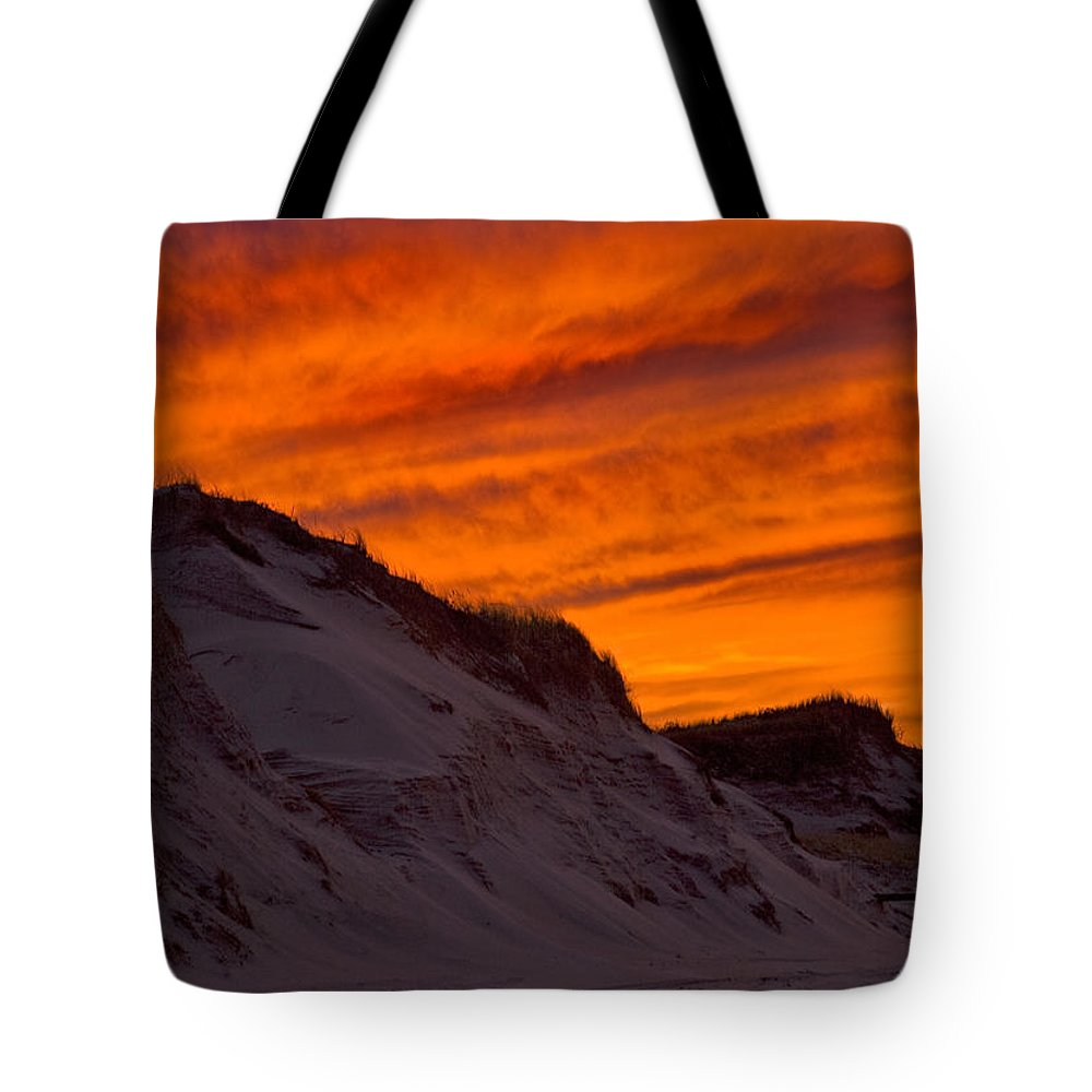Fire Tote Bag featuring the photograph Fiery Sunset Over The Dunes by Charles Harden