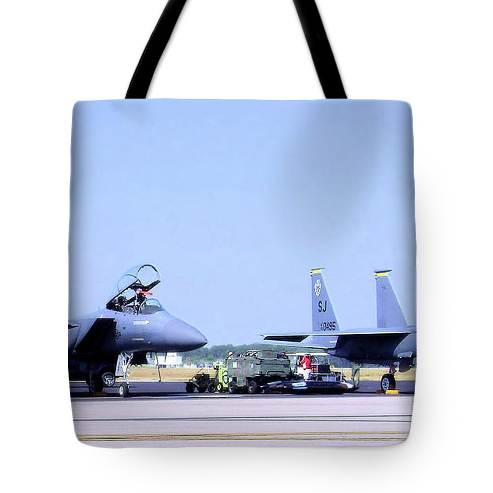 Fighters Tote Bag featuring the photograph Fighters by Eric Pearson