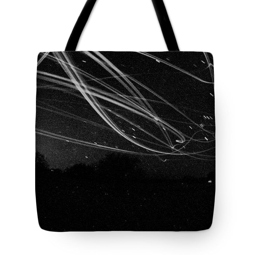 Night Tote Bag featuring the photograph Fighting The Dark by David S Reynolds