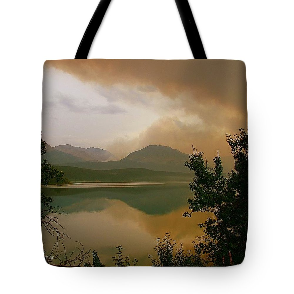 St Mary Lake Tote Bag featuring the photograph Fire Over St Mary Lake by Tracey Vivar