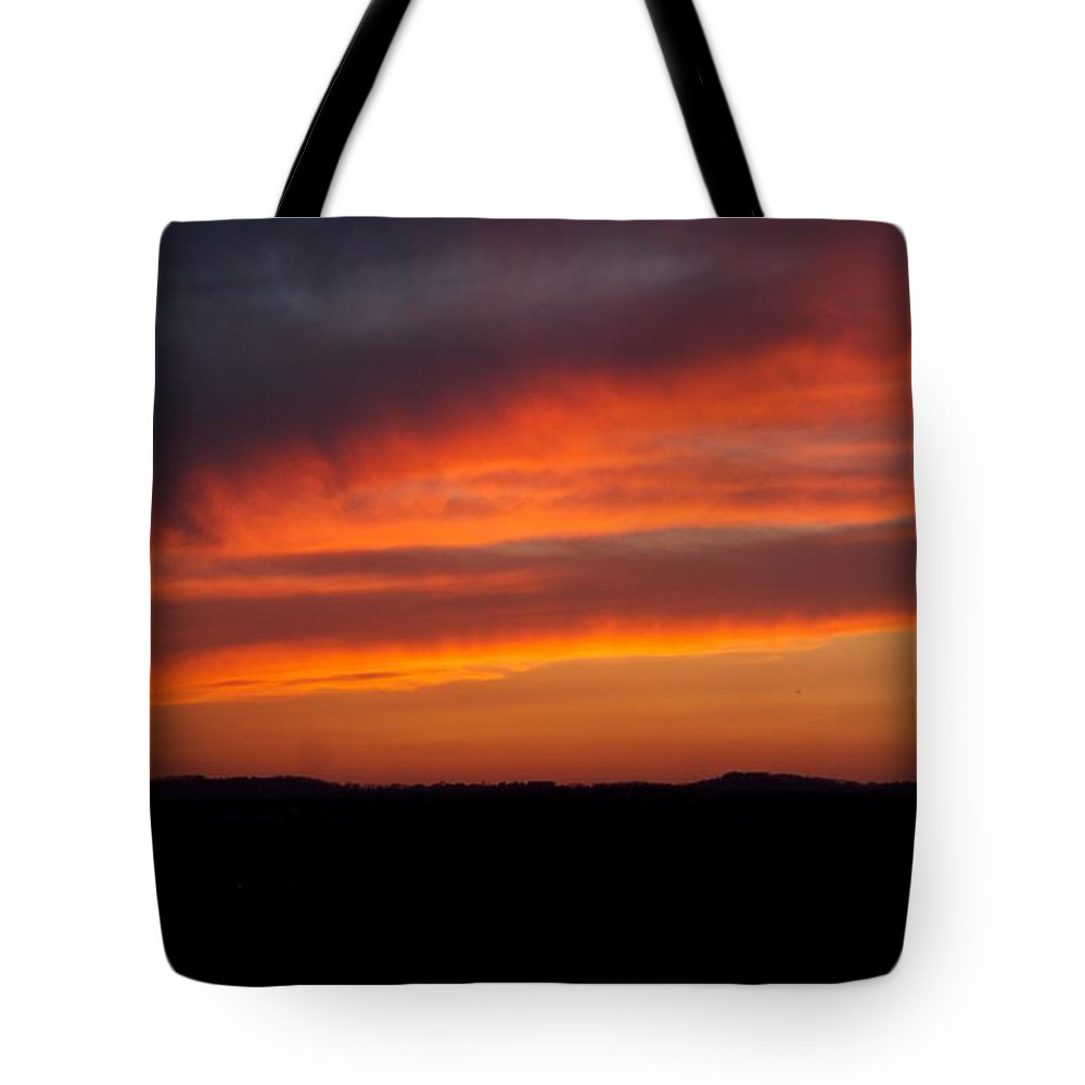 Red Sunset Tote Bag featuring the photograph Firey Skies by Toni Berry