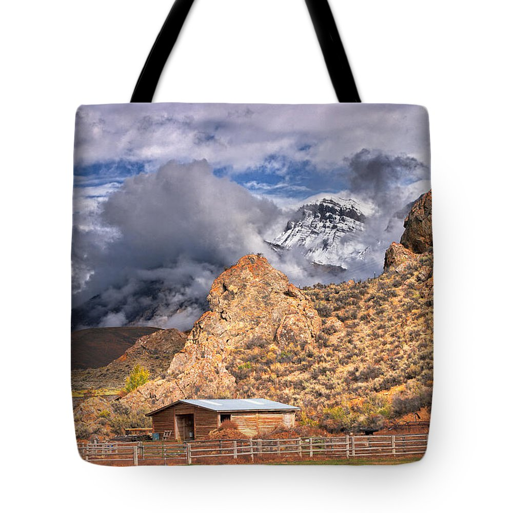 Snowy Mountains Tote Bag featuring the photograph First Snow On The Hills by Grant Groberg