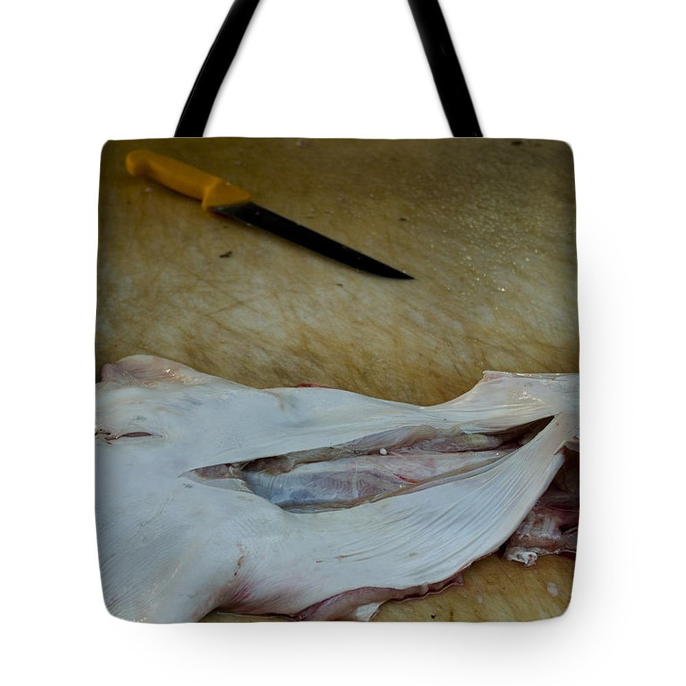 Photography Tote Bag featuring the photograph Fish And Knife On A Cutting Board by Todd Gipstein