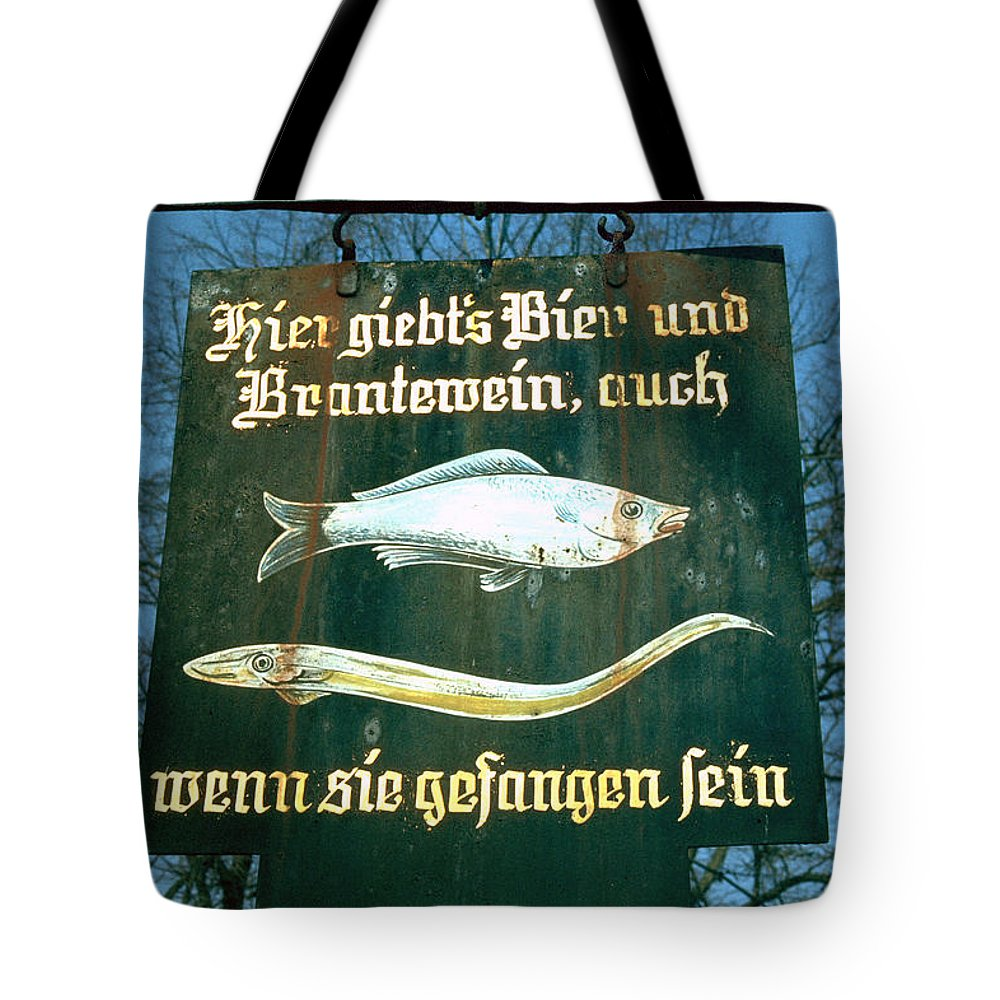 Store Sign Tote Bag featuring the photograph Fish by Flavia Westerwelle