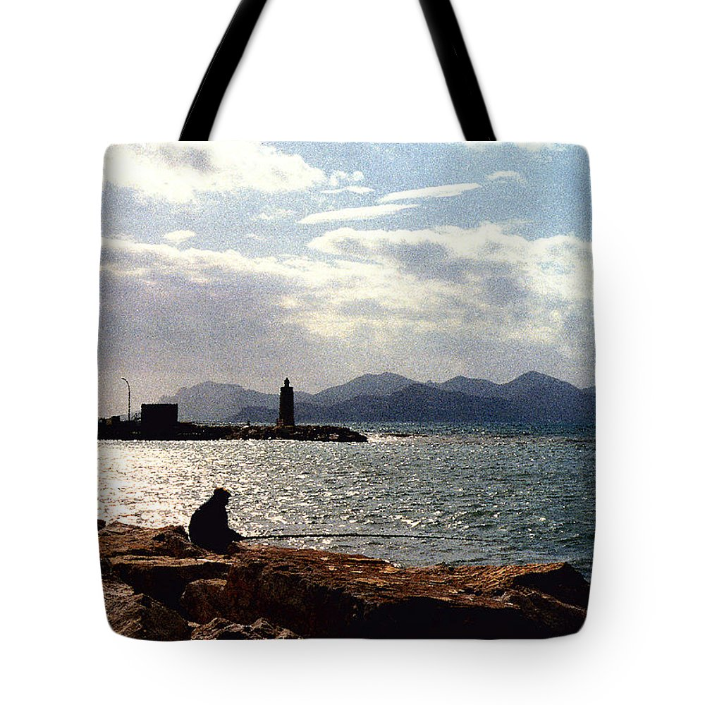 Fisherman Tote Bag featuring the photograph Fisherman In Nice France by Nancy Mueller