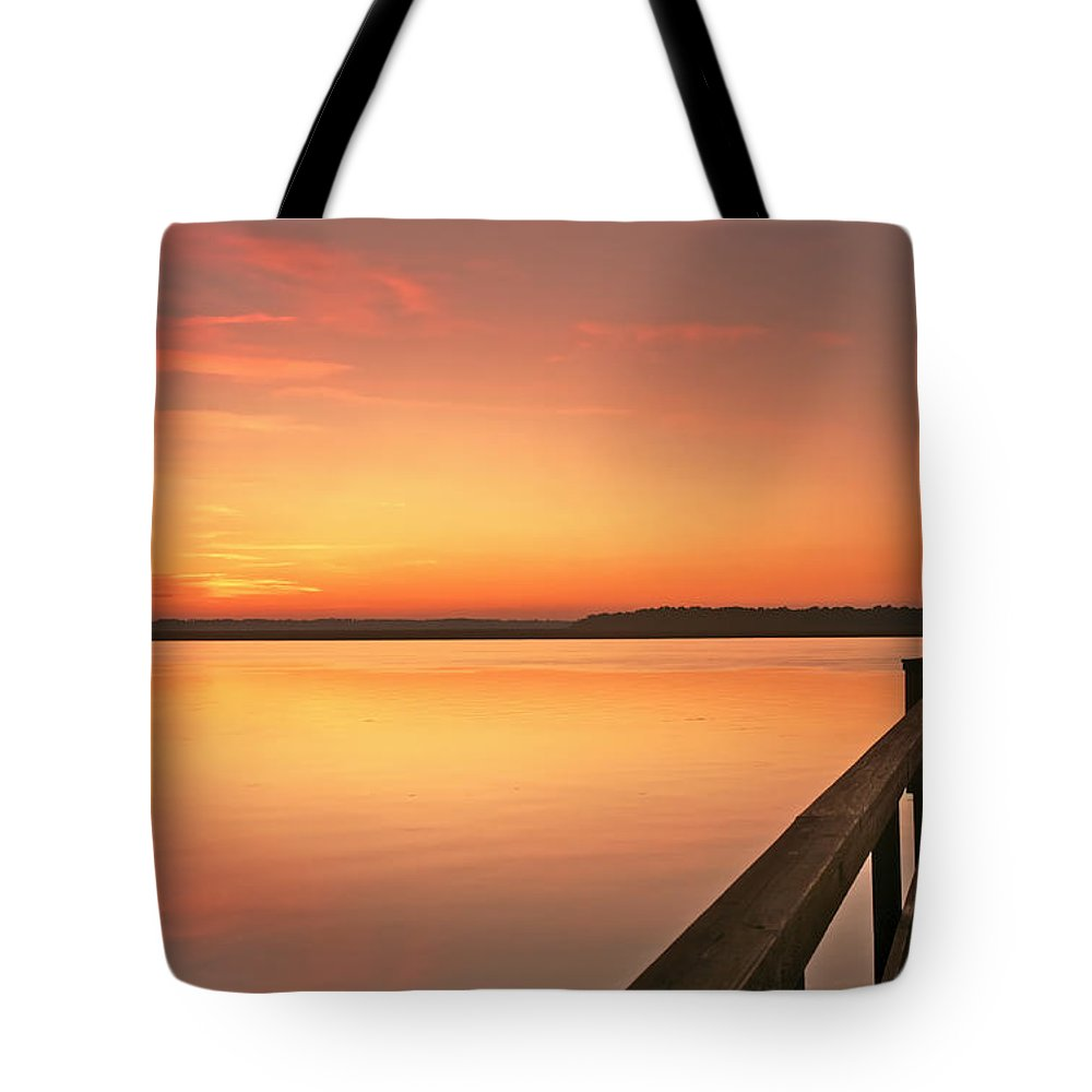 Sunset Tote Bag featuring the photograph Fisherman by Phill Doherty
