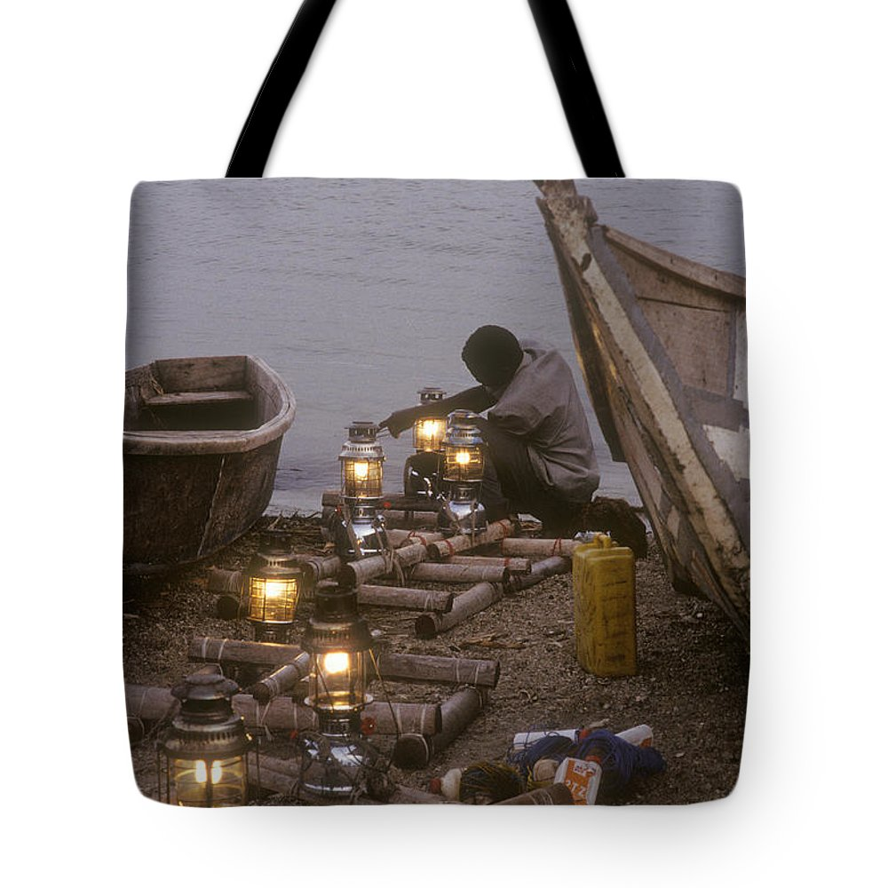 Uganda Tote Bag featuring the photograph Fisherman Prepares Lanterns For Night by Michael S. Lewis