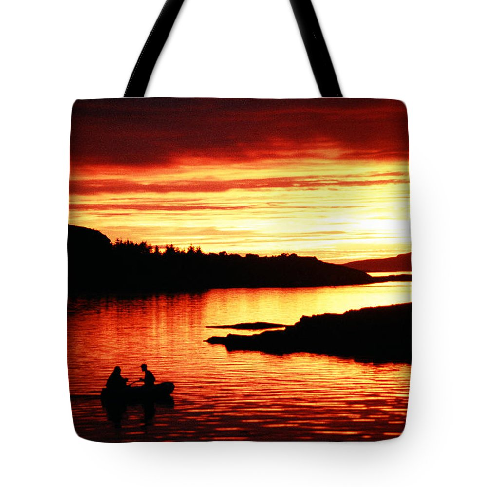 Men Tote Bag featuring the photograph Fishermen On The Lake. by Oscar Williams