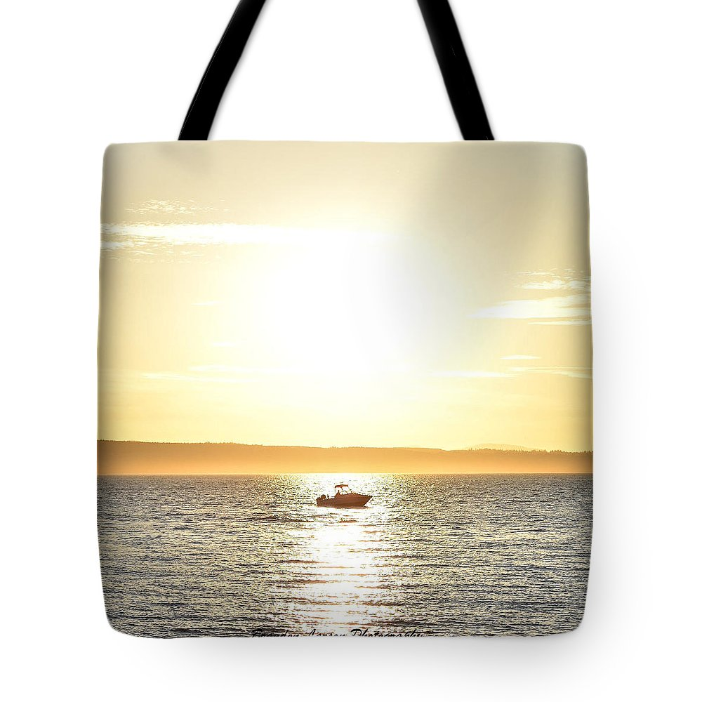 Tote Bag featuring the photograph Fishing At Sunset by Brandon Larson