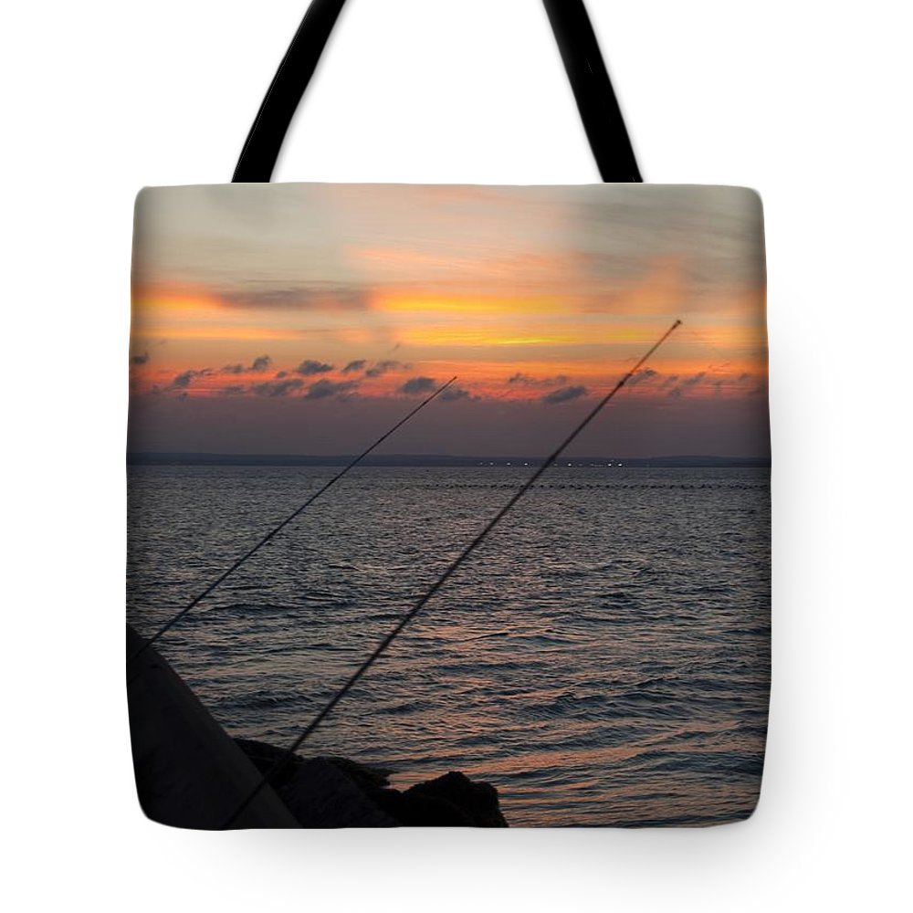 Fishing Tote Bag featuring the photograph Fishing At Sunset by Steven Natanson