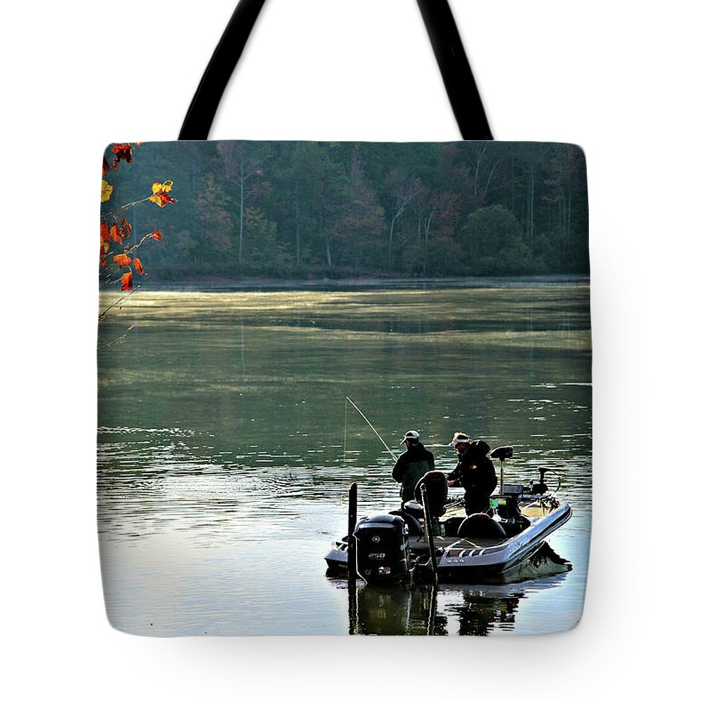 Fishing Tote Bag featuring the photograph Fishing by John Lewis