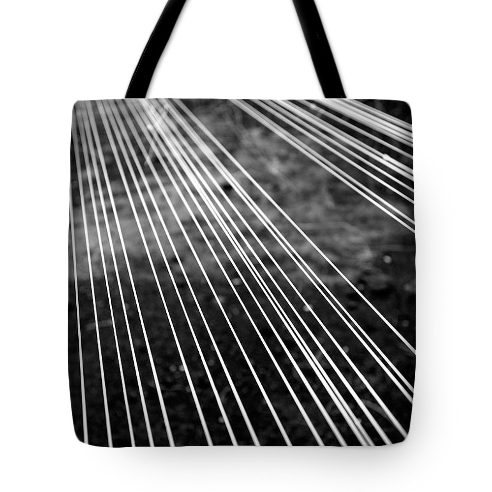 Abstract Tote Bag featuring the photograph Fishing Lines by Gaspar Avila