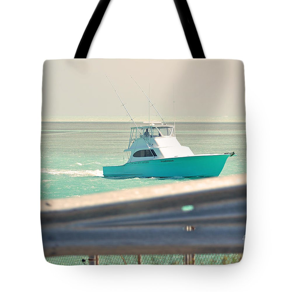 Key West Florida Tote Bag featuring the photograph Fishing On The Sea by Davids Digits