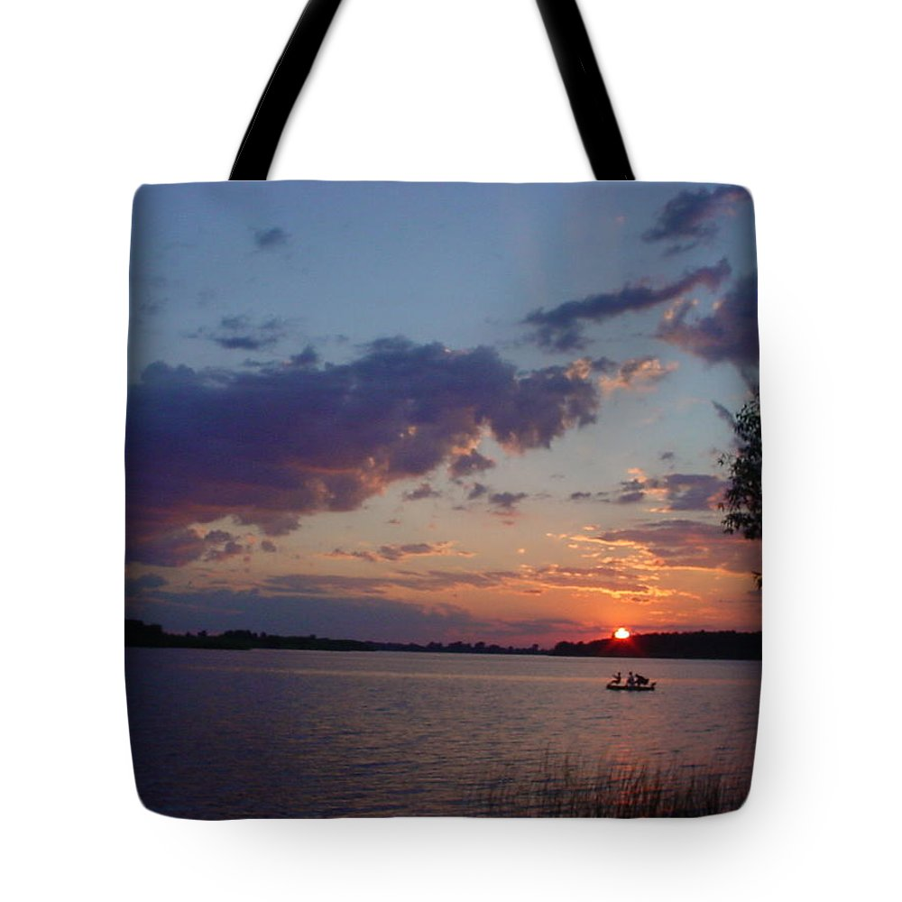 St.lawrence River Tote Bag featuring the photograph Fishing On The St.lawrence River. by Jerrold Carton