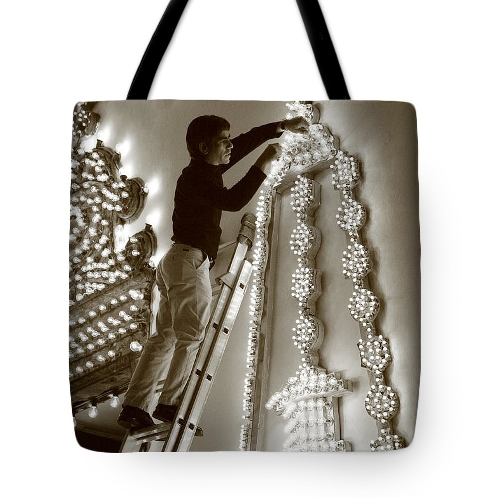 Decorations Tote Bag featuring the photograph Fixing A Glitch by Gaspar Avila