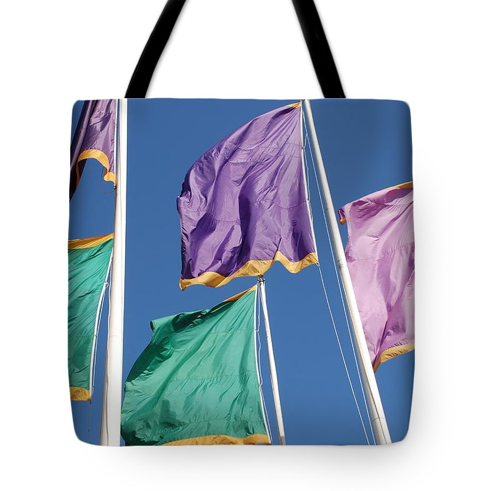 Flags Tote Bag featuring the photograph Flags by Rob Hans