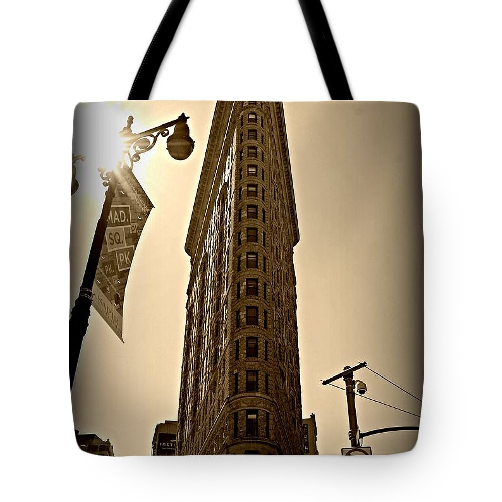 'new York City' Tote Bag featuring the photograph Flatiron Sepia by Randy Aveille