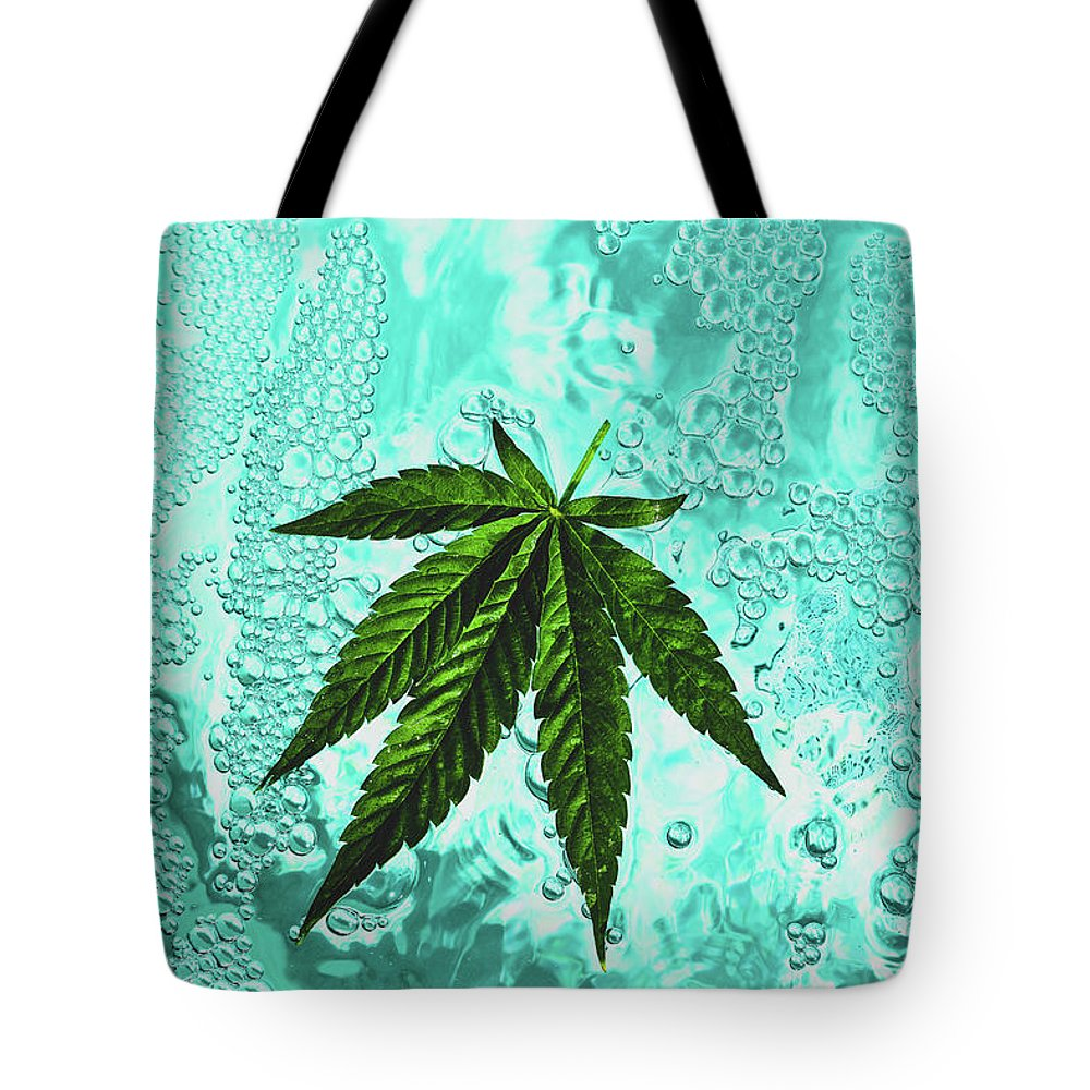 Floating Marijuana Leaf Tote Bag featuring the photograph Float by Michelle Keena