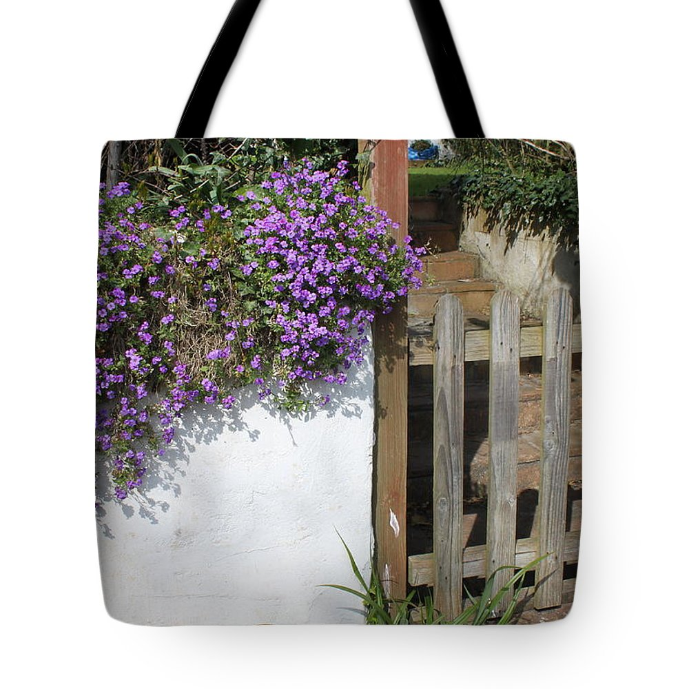 Flowers Tote Bag featuring the photograph Flower Wall by Lauri Novak