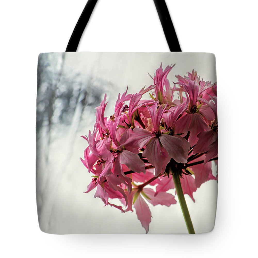 Flower Tote Bag featuring the photograph Flowers and Ice by Alana Thrower