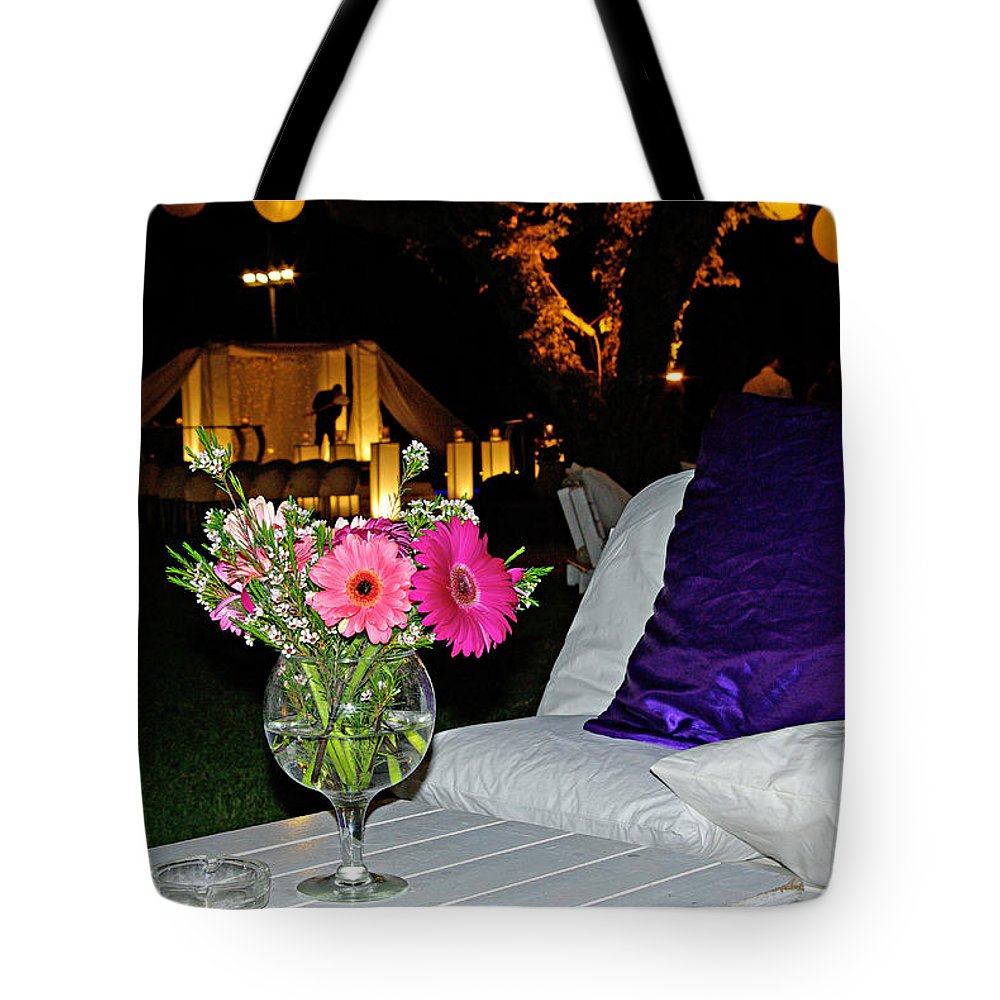 Flowers Tote Bag featuring the photograph Flowers In A Vase On A White Table by Zal Latzkovich