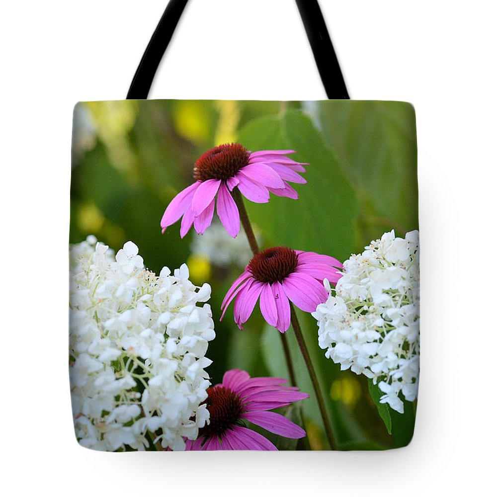 Garden Tote Bag featuring the photograph Flowers That Contrast by Janet Rockburn
