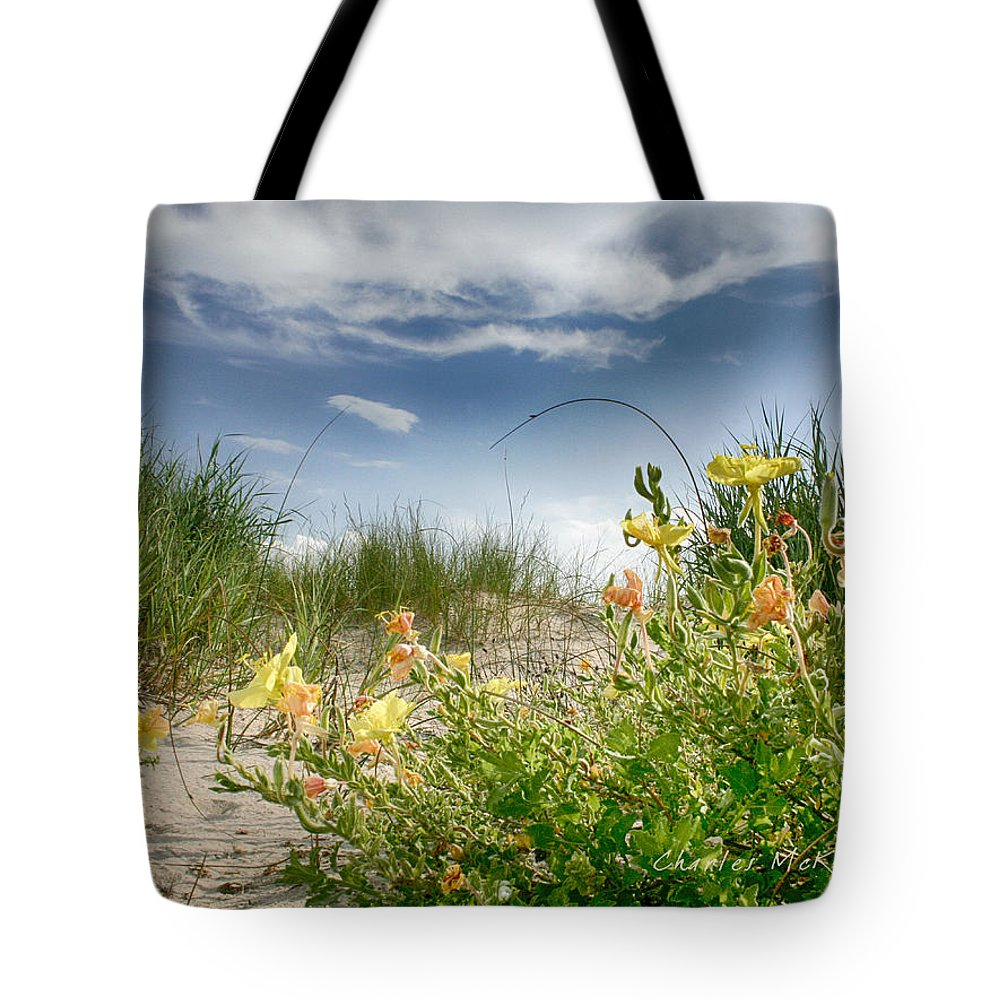 Sand Tote Bag featuring the photograph Flowery Dunes by Charles McKelroy