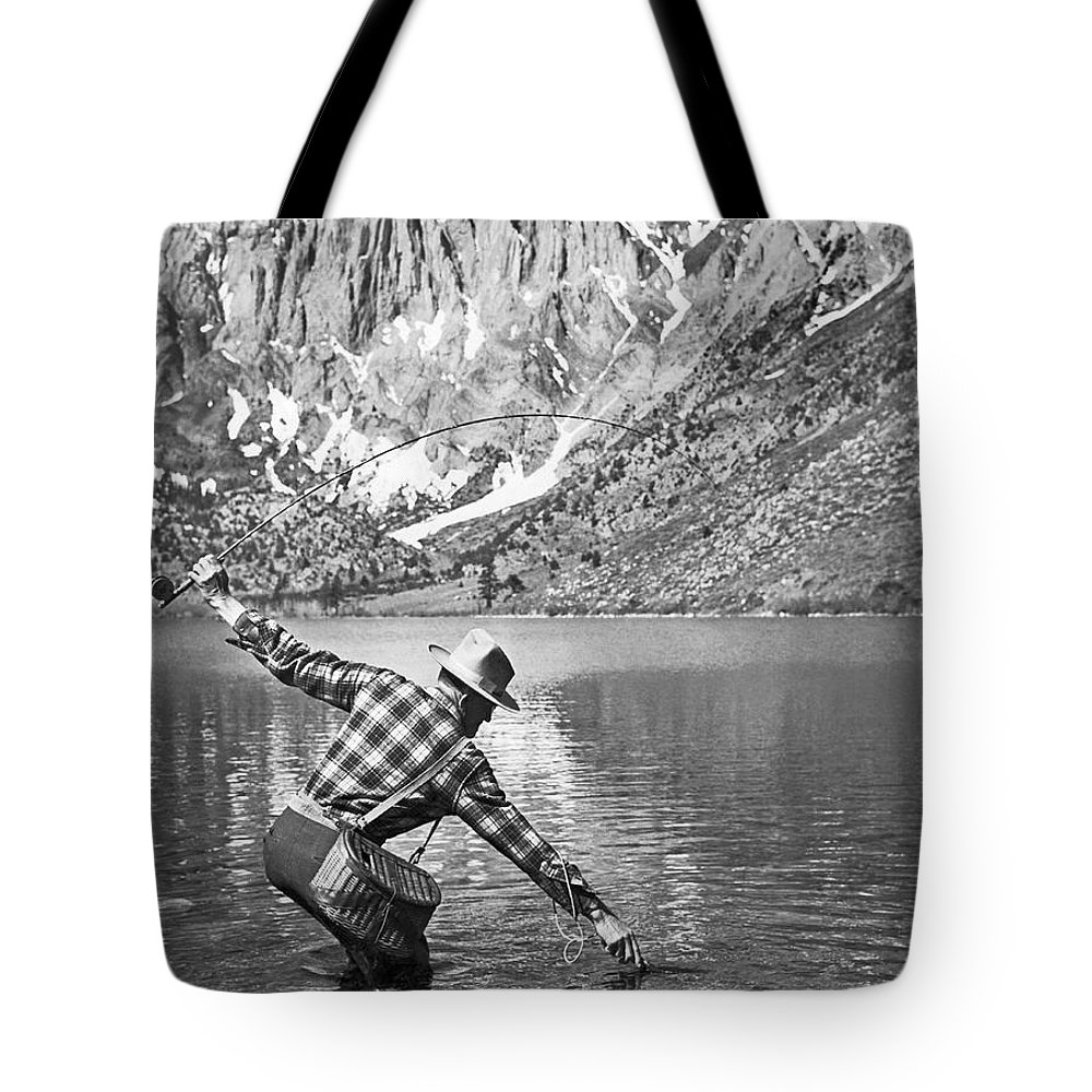 1 Person Tote Bag featuring the photograph Fly Fishing In A Mountain Lake by Underwood Archives
