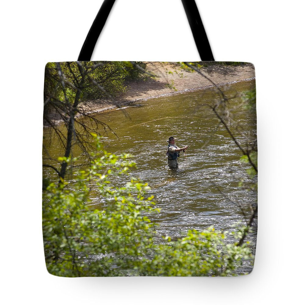Fishing Tote Bag featuring the photograph Fly Fishing by Louise Magno