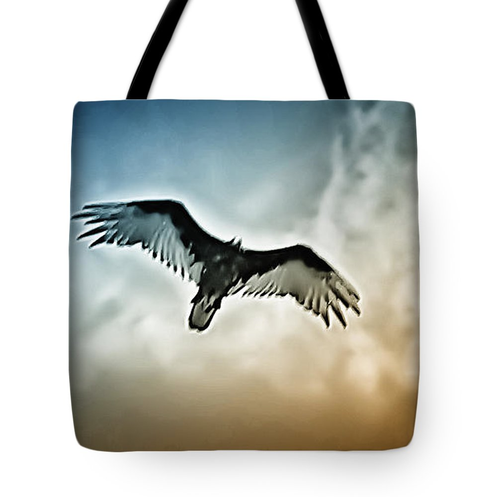 Falcon Tote Bag featuring the photograph Flying Falcon by Bill Cannon
