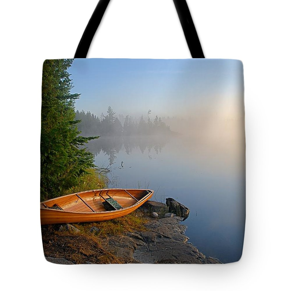 Boundary Waters Canoe Area Wilderness Tote Bag featuring the photograph Foggy Morning On Spice Lake by Larry Ricker