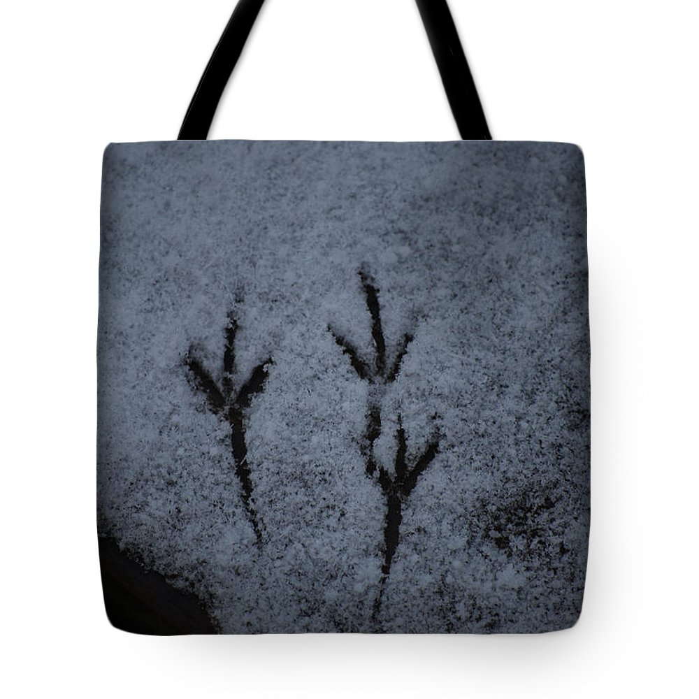Snow Tote Bag featuring the photograph Footprints In The Snow by Lori Tambakis