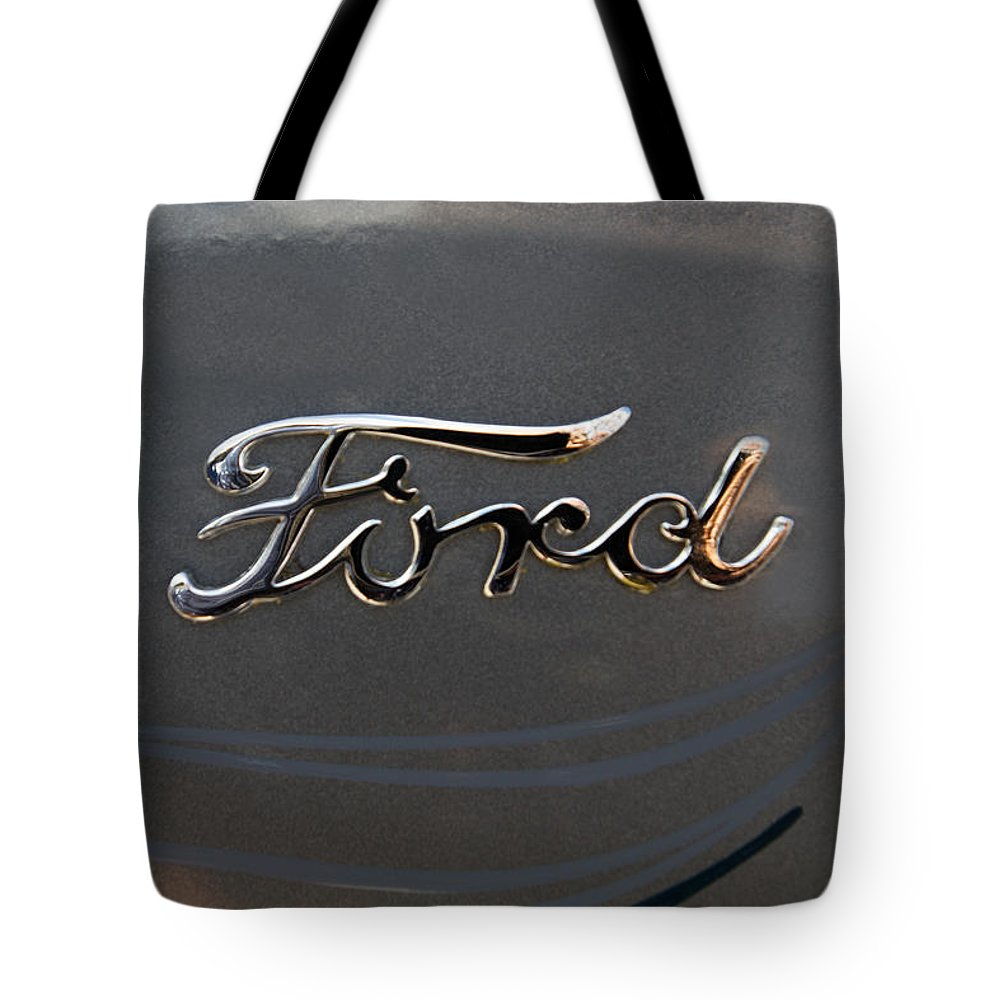 Car Emblem Tote Bag featuring the photograph Ford Antique Auto Emblem by J Darrell Hutto