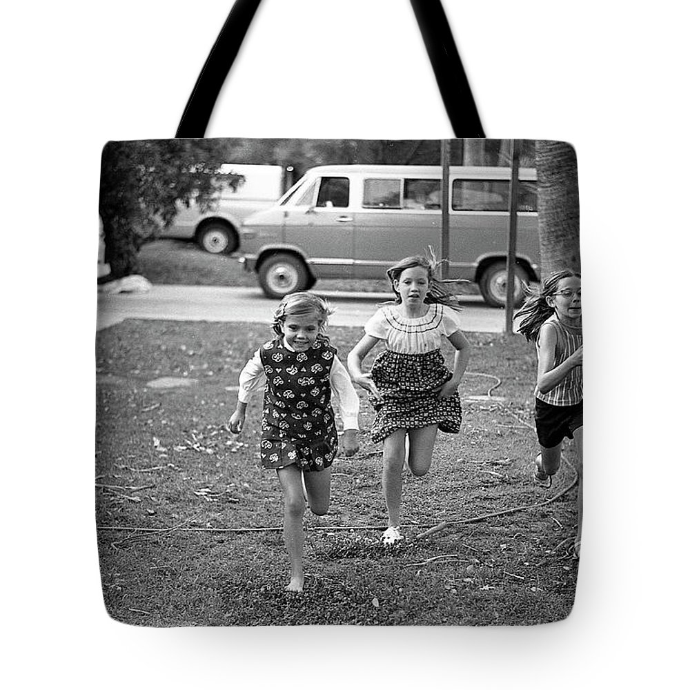 Racing Tote Bag featuring the photograph Four Girls Racing, 1972 by Jeremy Butler