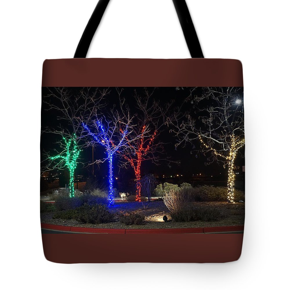 Winter Tote Bag featuring the photograph Four Lighted Trees by Susan Brown