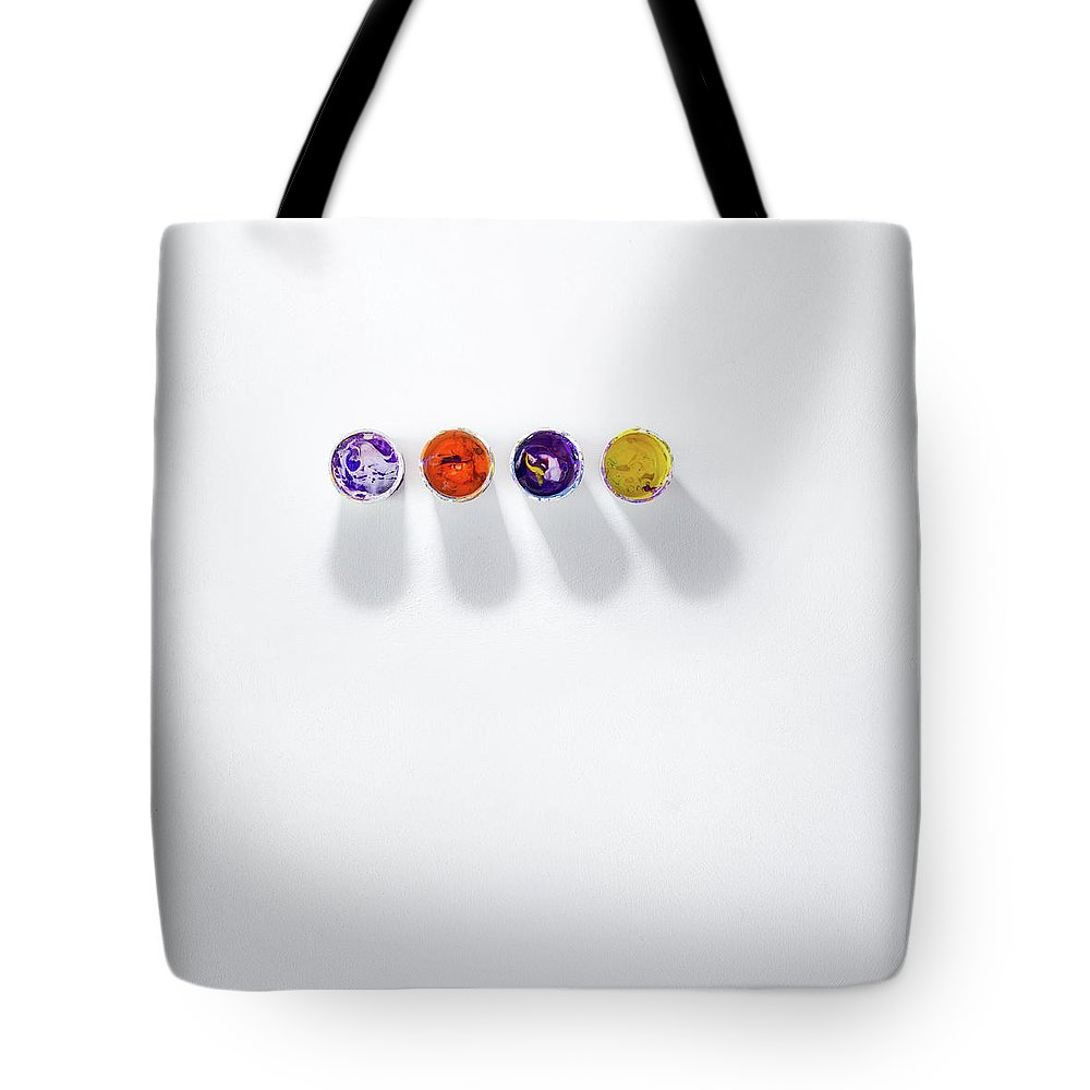 Paint Tote Bag featuring the photograph Four Small Containers Of Paint by Scott Norris