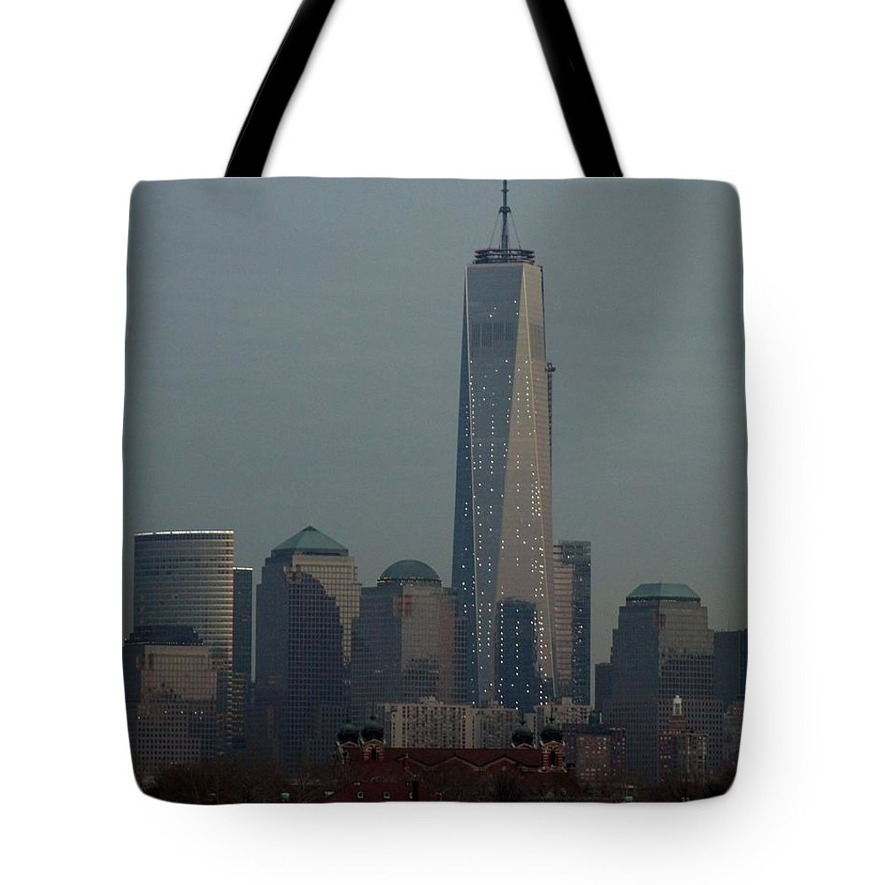 Freedom Tote Bag featuring the photograph Freedom And Ellis Island by John Wall