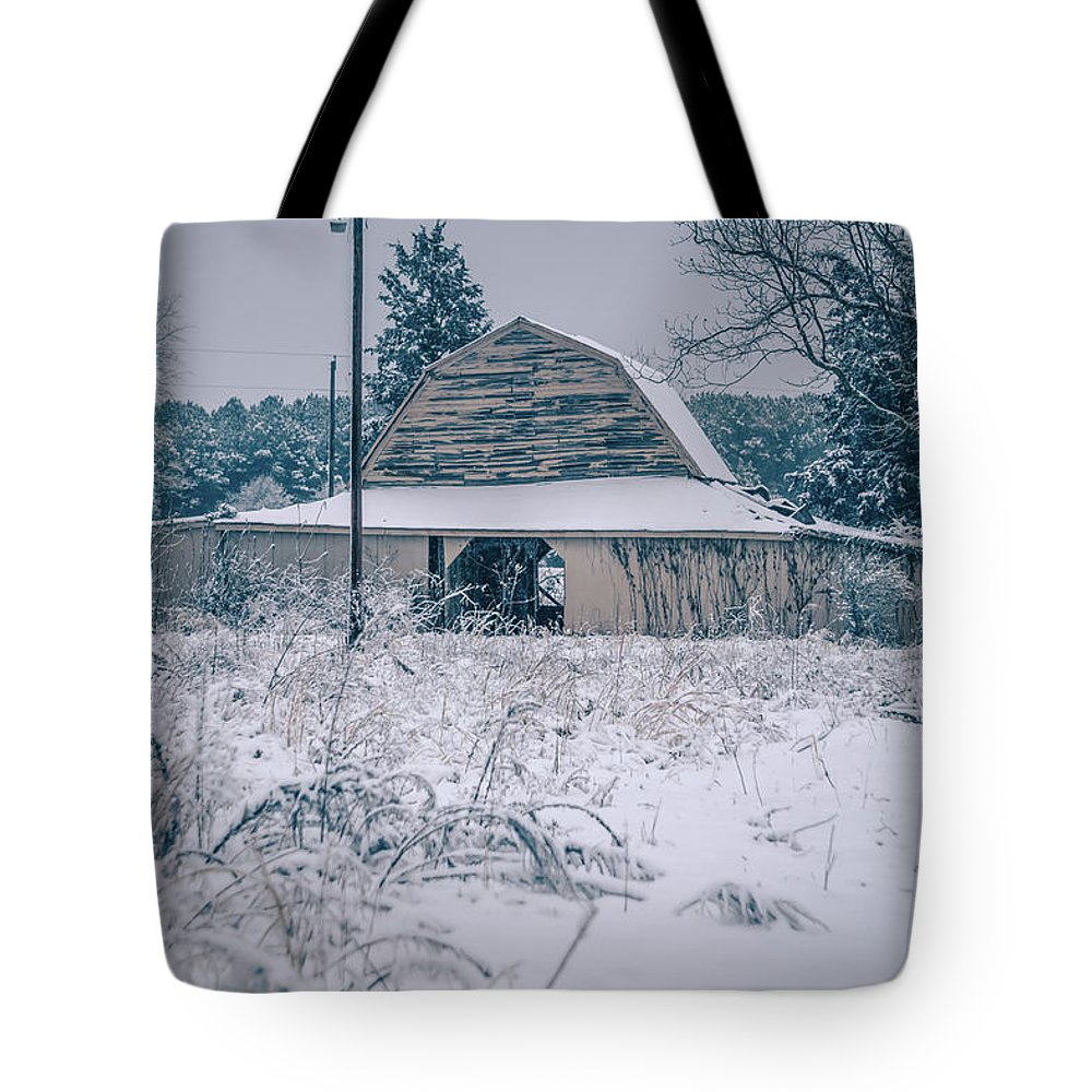 Field Tote Bag featuring the photograph Fresh Snow Sits On The Ground Around An Old Barn by Alex Grichenko
