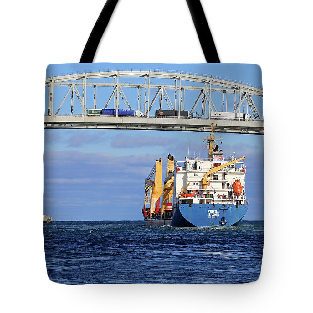 Frieda Tote Bag featuring the photograph Frieda And Blue Water Bridge by Mary Bedy