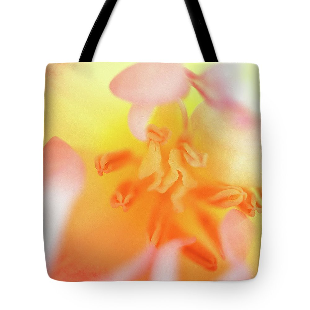 Internal Beauty Of A Tulip Tote Bag featuring the photograph From The Heart by Bill Morgenstern