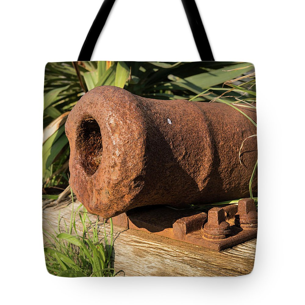 Cannon Tote Bag featuring the photograph Front End Of An Old Rusty Cannon Lying On The Floor by Stefan Rotter